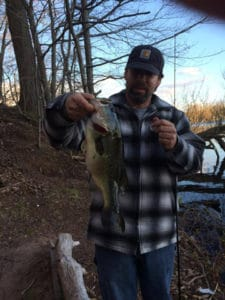 Jeff Cerritelli with a bass caught in 2-1/2ft of water immediately following the turnover last year in 47deg water